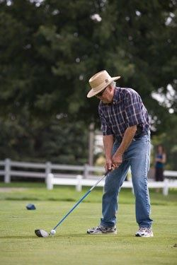 Man Preparing to Swing While Playing Golf